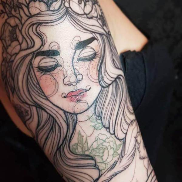 Oberschenkel Tattoo Blume